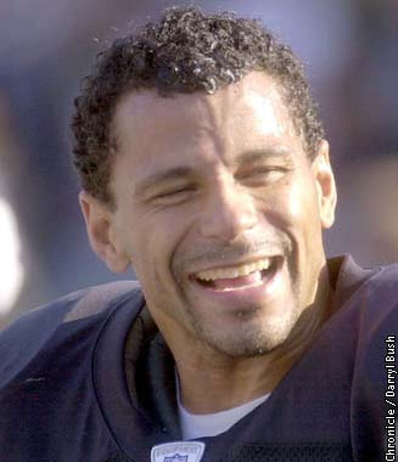RAIDERS30S-C-29SEP02-SP-DB --- The Raiders' Rod Woodson, celebrates on the bench after his third interception of game in the fourth quarter. The Oakland Raiders played the Tennessee Titans at Network Associates Coliseum on Sunday, September 29, 2002.  (PHOTO BY DARRYL BUSH/THE SAN FRANCISCO CHRONICLE)