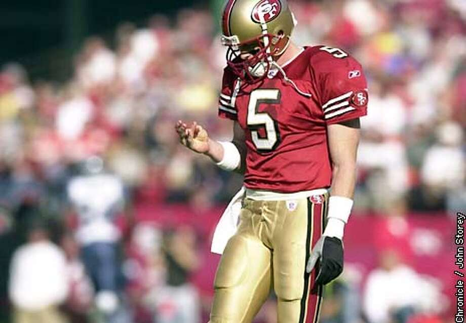 49ERS-C-01-DEC02-SP-JRS-The 49ers vs. the Seahawks at Candlestick Park. Jeff Garcia upset after throwing his second interception. Chronicle photo by John Storey.