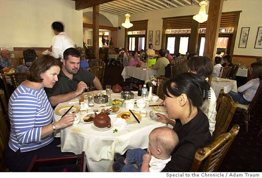 Event on 6/9/04 in Walnut Creek.  Reid Whelton, left, her husband Patrick Whelton, Grace Lee, second from right, and Alice Lee, holding 8-month-old Liam Whelton, eat lunch at Tin's Tea House Lounge in Walnut Creek June 8, 2004.  Adam Traum / The Chronicle Photo: Adam Traum