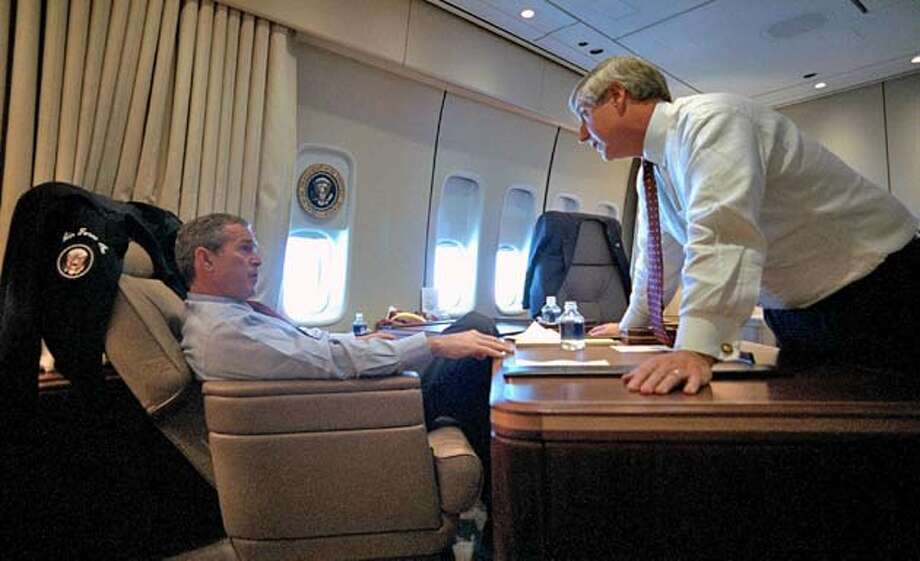 (NYT60) ABOARD AIR FORCE ONE -- June 17, 2004 -- TERROR-MINUTES -- President Bush speaks with Chief of Staff Andy Card aboard Air Force One Sept. 11, 2001. Bush's exact whereabouts are unknown. The nation has relived the morning of Sept. 11 countless times, but never with the harrowing detail and minute-by-minute drama of the report released Thursday by the independent commission investigating the attacks. The 29-page report recounts a frenetic 149 minutes unlike anything ever faced by the nation�s aviation and military defenses. (Eric Draper/The White House) XNYZ Photo: Eric Draper