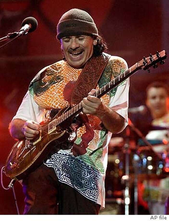 Carlos Santana at the Cotton Bowl during the Eric Clapton Crossroads Guitar Festival Sunday, June 6, 2004, in Dallas. (AP Photo/Tony Gutierrez) Photo: TONY GUTIERREZ
