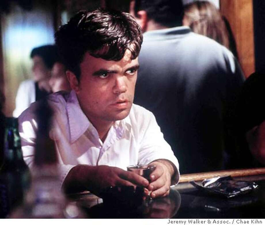 """**FILE**Peter Dinklage appears in a scene in the 2002 film """"The Station Agent,"""" in this undated promotion photo. It was announced in Los Angeles that Dinklage received a Screen Actor Guild award lead actor nomination, on Thursday, Jan. 15, 2004(AP Photo/Jeremy Walker & Assoc. / Chae Kihn)  ALSo RAN: 03/01/2004 (3-Star) Peter Dinklage, nominated for a best-actor award by the Screen Actors Guild for &quo;The Station Agent,&quo; opted not to change his name. , AN UNDATED PHOTO Photo: CHAE KIHN"""