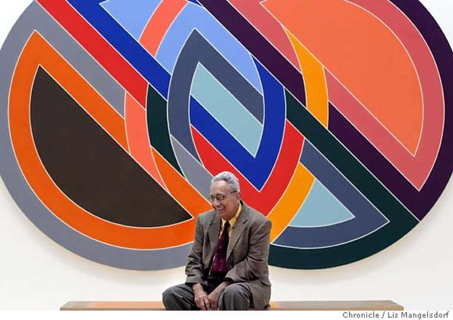 "stella005_lm.JPG Event on 6/12/04 in San Francisco. Artist Frank Stella in front of his painting titled ""Firuzabad"", a 1970 acrylic on canvas. Painter Frank Stella with his work that is hanging at the SFMOMA.  Liz Mangelsdorf / The Chronicle Photo: Liz Mangelsdorf"