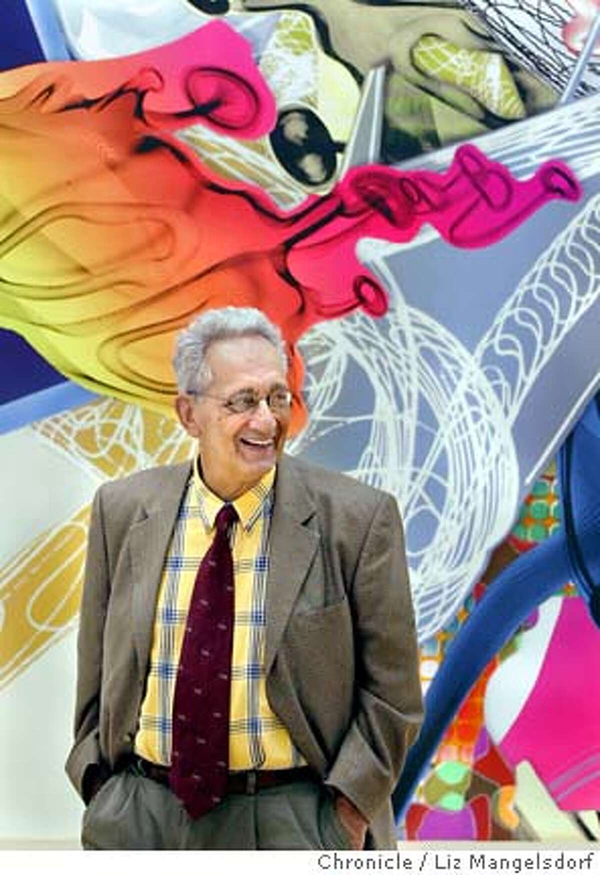 """stella005_lm.JPG Event on 6/12/04 in San Francisco. Frank Stella, in front of his painting titles """"The Duel"""", which is an acrylicd on canvas, 2001. Painter Frank Stella with his work that is hanging at the SFMOMA. Liz Mangelsdorf / The Chronicle"""