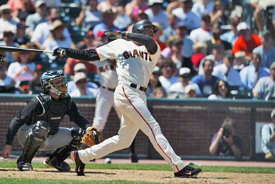 Event on 6/18/04 in San Francisco.  The San Francisco Giants Michael Tucker triples to drive in Barry Bonds and Ray Durham during the eighth inning, putting the Giants up 7-5 against the Toronto Blue Jays. The Giants went on to beat the Blue Jays 8-5 at SBC Park. � Chris Stewart / The Chronicle Photo: Chris Stewart