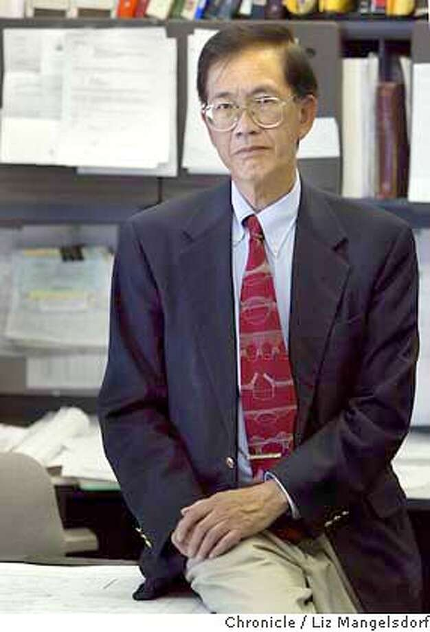 Event on 6/16/04 in San Francisco.  Lok Kwan in his office in San Francisco on Folsom St. He is one of the plaintiffs in a suit against the venerable Chinese Six Companies.  Liz Mangelsdorf / The Chronicle Photo: Liz Mangelsdorf