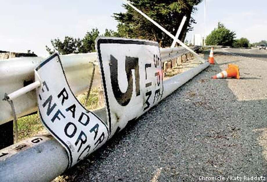PHOTO BY KATY RADDATZ--THE CHRONICLE  A light pole that also contains the speed limit sign is down. It's on Hwy 1 southbound, about 100 feet south of the Hwy 35 overpass. Photo: KATY RADDATZ
