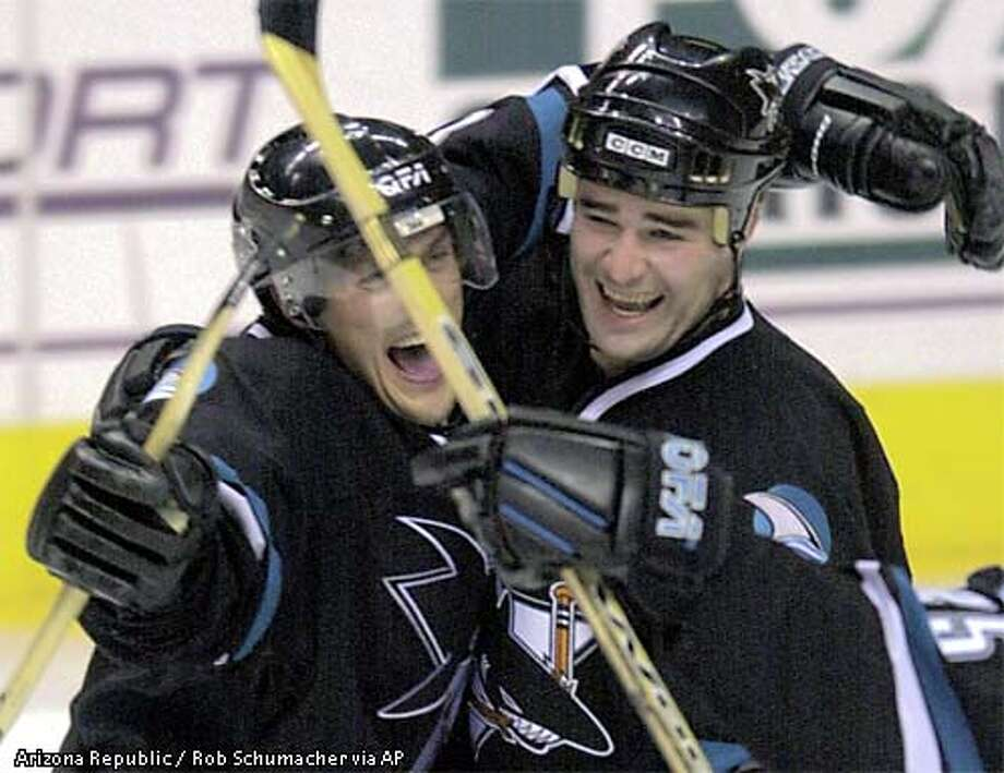 San Jose sharks' Teemu Selanne, left, celebrates with Patrick Marleau after scoring his overtime goal to defeat the Phoenix Coyotes 3-2 during NHL action Tuesday night, Dec. 3, 2002 at America West Arena in Phoenix.(AP Photo/  Arizona Republic, Rob Schumacher) Photo: ROB SCHUMACHER
