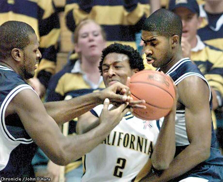 UC BERKELEY, CALIFORNIA Cal Bears v/s Howard Bison.  Cal's #2 A.J. Diggs was taken on by Qadir Habeeb who was literally trying to remove Digg's fingers from the basketball and Klye Williams was helping out.