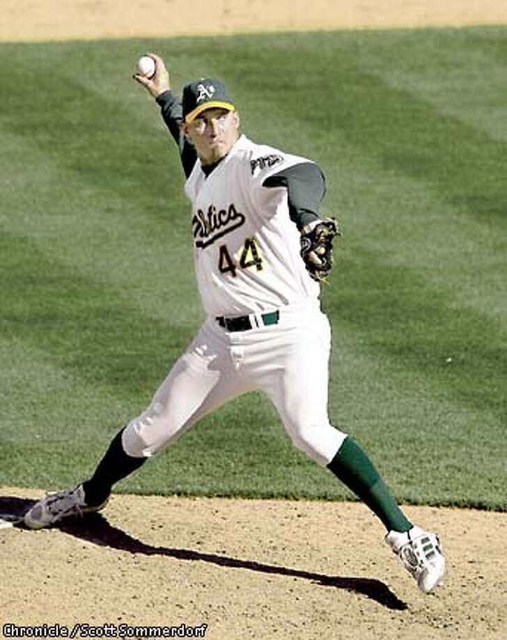 Athletics closer Billy Koch glares at the hitter while delivering a pitch in the 9th inning of the A's 7-5 win over Texas Sunday, 9/22/2002. Koch got his 43rd save of the season on the day when Oakland won it's 99th. (SF CHRONICLE PHOTO BY SCOTT SOMMERDORF) Photo: SCOTT SOMMERDORF