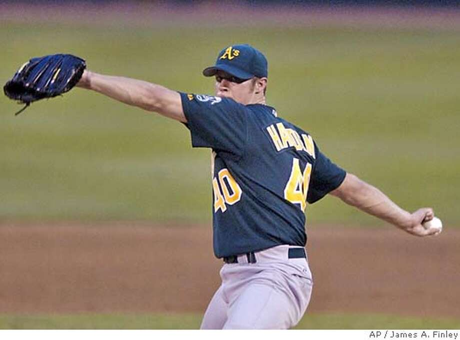 Oakland Athletics starting pitcher Rich Harden pitches during the fifth inning against the St. Louis Cardinals in their Interleague baseball game in St. Louis Wednesday, June 16, 2004. (AP Photo/James A. Finley) Photo: JAMES A. FINLEY