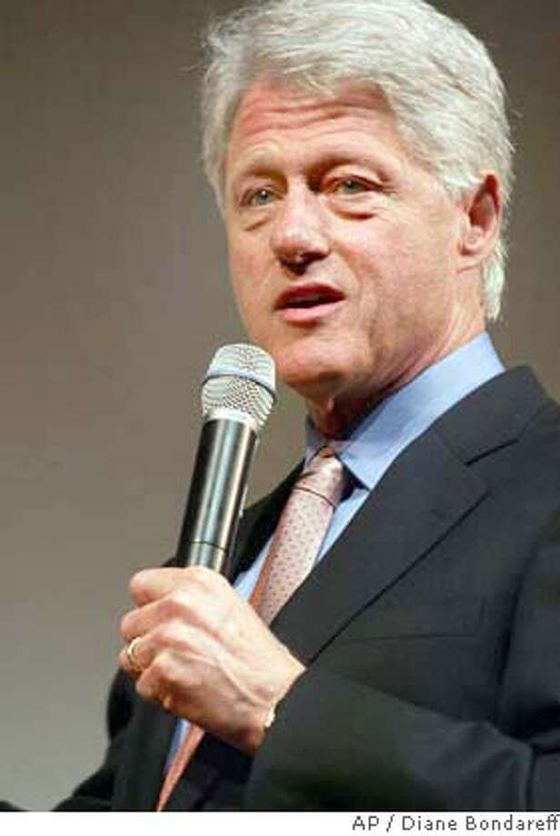 "Former President Bill Clinton addresses the audience at the New York premiere of ""The Hunting of the President,"" Wednesday, June 16, 2004. The film, which claims to expose ``the 10-year campaign to destroy Bill Clinton,'' is a 90-minute documentary which re-creates interviews conducted for the best-selling book of the same name by Joe Conason and Gene Lyons. (AP Photo/Diane Bondareff) Photo: DIANE BONDAREFF"