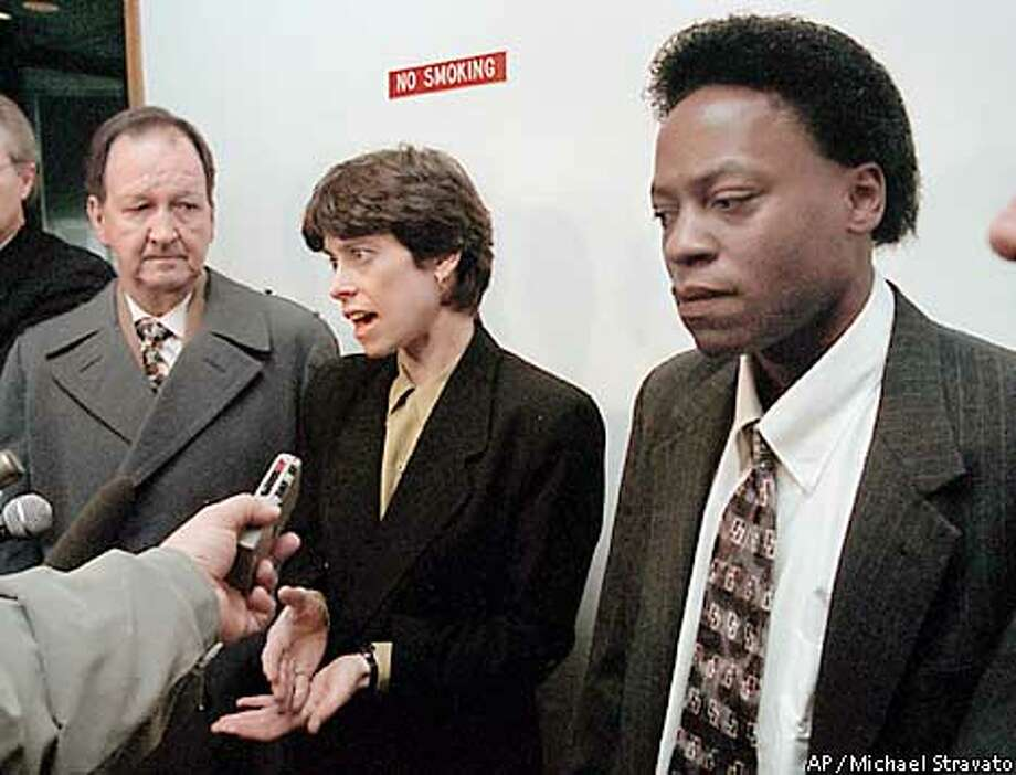 **FILE**Tyron Garner, right, and John Lawrence, left, listen to their lawyer, Suzanne Goldberg, center, speak to reporters after a Harris County Criminal Court judge found them guilty and fined them for homosexual conduct on Dec. 22, 1998, in Houston. The Supreme Court said Monday, Dec.2, 2002, it would consider whether states can punish homosexuals for having sex, a case that tests the constitutionality of sodomy laws in 13 states. The justices will review the prosecution of these two men under a state law making it a crime to engage in same-sex intercourse. The two men, arrested for having sex in a private home, appealed their conviction under Texas' sodomy law. (AP Photo/Michael Stravato,file) Photo: MICHAEL STRAVATO