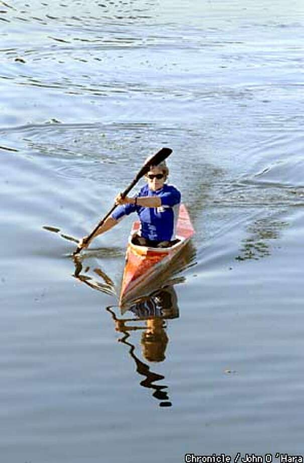 WEATHER-C-02DEC02-MT-JO Weather. December 2 nd, in the winter, with a temperature around 70 and no breeze. Susan Starbird of Sebastopol, a Marketing Consultant in Petaluma took to the river for her lunch hour. The water was glassy clam on this winter day. photo/John O'hara