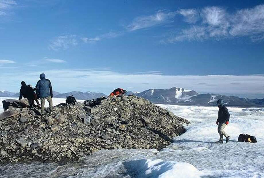 This photo is from a 6-person expedition team in July 2003 that is believed to be first humans to set foot on the northernmost land on Earth, a small island about 140 feet long off the northern tip of Greenland and 432 miles from the North Pole.