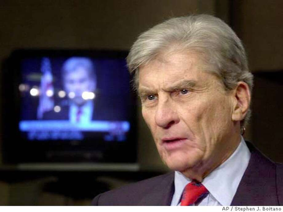 Senate Armed Services Committee Chairman Sen. John Warner, R-Va., is interviewed by CNN on Capitol Hill Thursday, Oct. 12, 2000, to discuss an apparent suicide terrorist attack on a Navy destroyer in the Arabian Peninsula. An apparent suicide terrorist bombing tore into the USS Cole Thursday, killing four Americans, injuring three dozen and leaving 12 missing, the Defense Department said. (AP Photo/Stephen J. Boitano) w/INTEL07 jump Photo: STEPHEN J. BOITANO