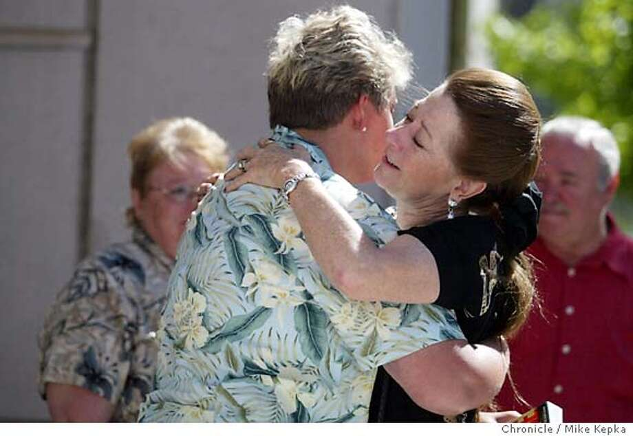 Judy Nemec, Daughter of the two of the victims, Ivan and Annette Stineman, receives a hug outside the Martinez courthouse by an unidentified woman after a guilty verdict was read.  The Helzer case comes to one of several vedicts today 6/16/04 in Martinez. Mike Kepka / The Chronicle Photo: Mike Kepka