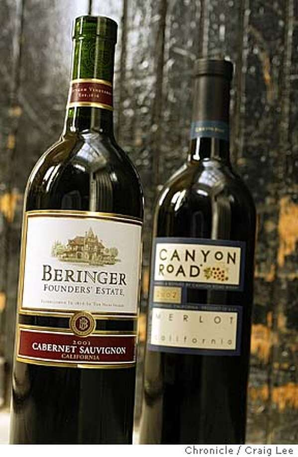 For Bargain Wines column. Photo of Canyon Road 2002 Merlot (right) and Beringer Founders' Estate 2001 Cabernet Sauvignon.  Event on 6/11/04 in San Francisco. Craig Lee / The Chronicle Photo: Craig Lee