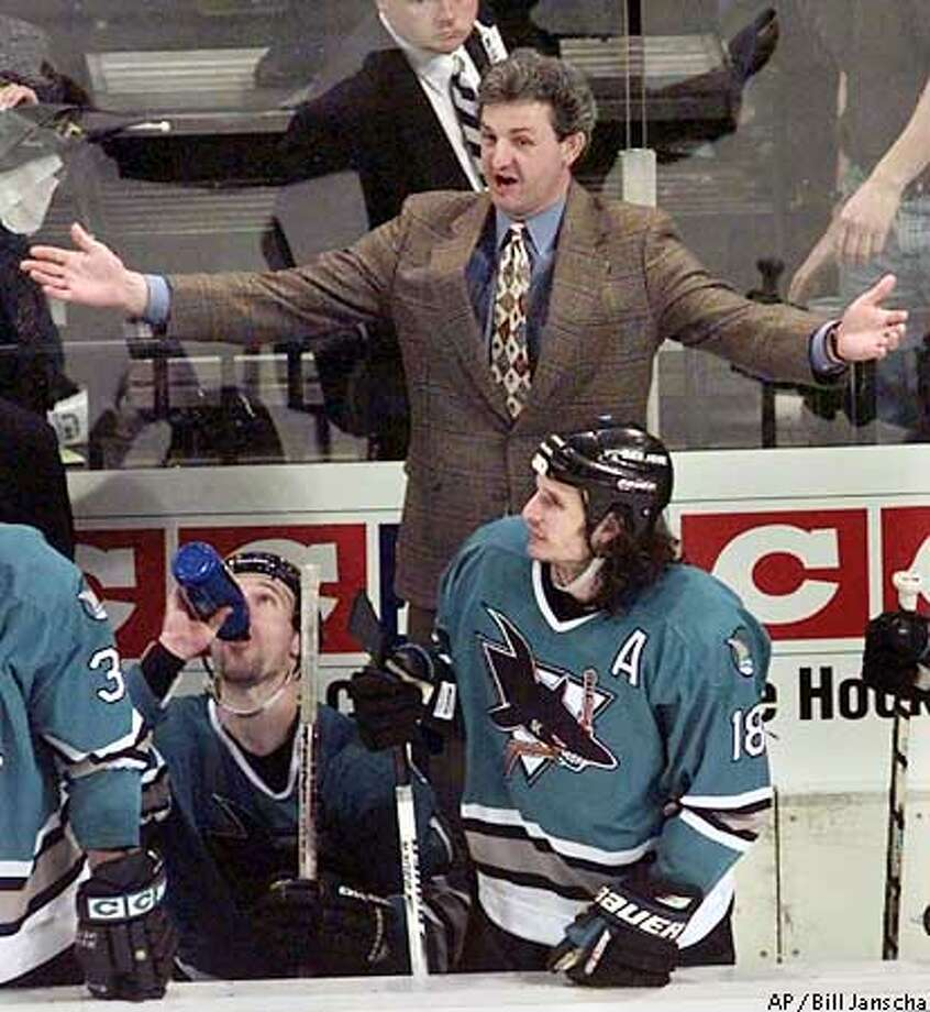 San Jose Sharks coach Darryl Sutter and Sharks center Mike Ricci (18) complain to officials after the Dallas Stars scored the winning goal during the third period in Dallas, Thursday night, April 30, 1998. The Stars took the fifth game of their first round playoff series 3-2 to take a 3-2 lead in the series. (AP Photo/Bill Janscha) ALSO RAN: 05/05/98. (3star edition, sports)