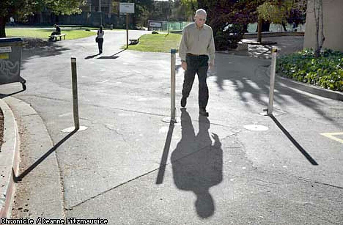 UC Berkeley professor Marty Banks is putting together a tour of optical illusions on campus. He is walking in between these vertical rods stuck in the sidewalk. The shadows appear to be fanning up but they are actually parallel. CHRONICLE PHOTO BY DEANNE FITZMAURICE
