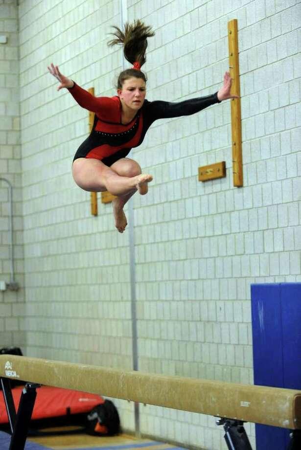 Fairfield Warde's Tori Gallatti competes on the balance beam, during a gymnastics meet in Weston, Conn. on Thursday January 26, 2012. Photo: Christian Abraham / Connecticut Post