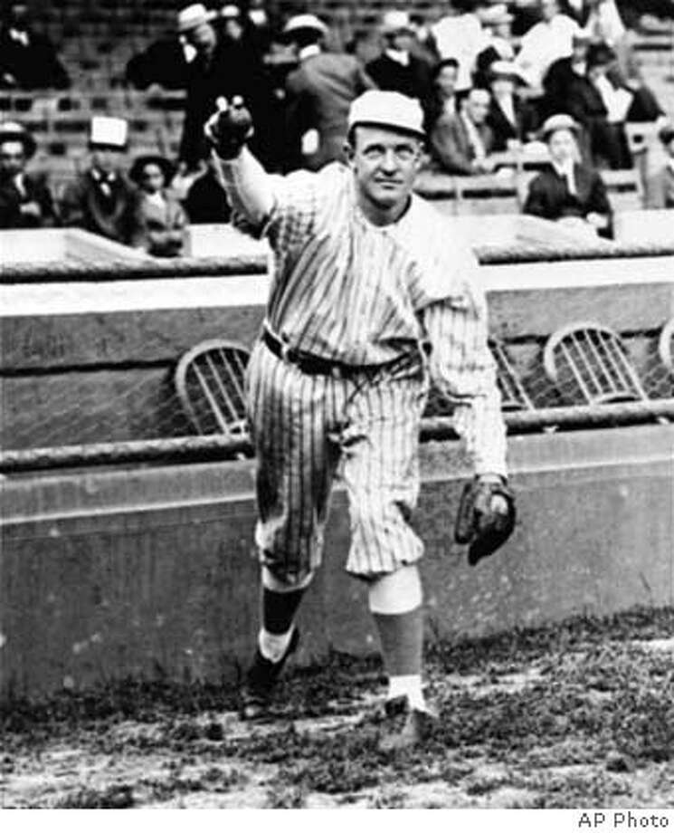 "Christy Mathewson is seen pitching around 1910. He was the New York Giants star hurler from 1906-1916. ""Matty"" won 373 games. (AP Photo)"