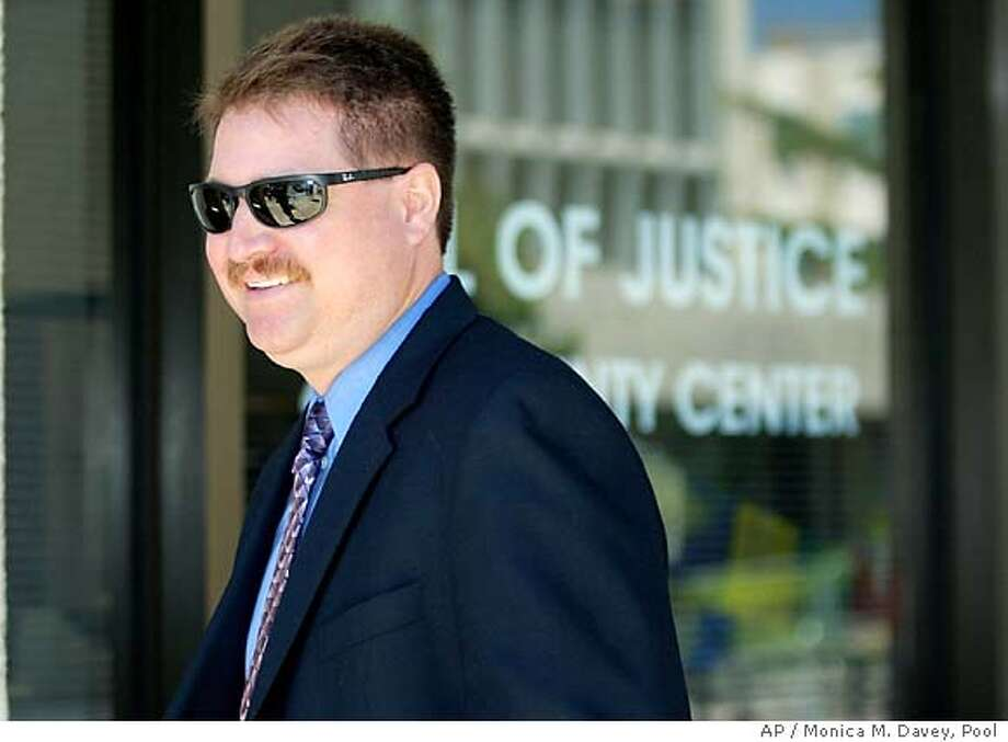Jon Evers, a Modesto Police detective and a witness in the Scott Peterson trial, leaves the San Mateo Courthouse for the lunch break during the double murder trial of Scott Peterson in Redwood City, California, Tuesday June 15, 2004. Peterson is accused of the double murder of his wife Laci and their unborn son Conner  EPA/MONICA M. DAVEY, POOL Photo: MONICA M. DAVEY