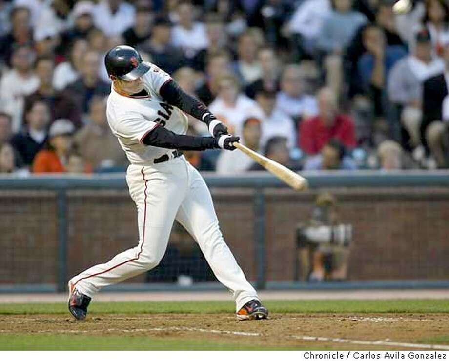 The Giants's Pedro Feliz hits for a triple in the bottom of the fourth inning of play. The San Francisco Giants played the Toronto Blue Jays at SBC Park in San Francisco, Ca., on Tuesday, June 15, 2004.  Event on 6/15/04 in San Francisco, CA. Photo by Carlos Avila Gonzalez / The San Francisco Chronicle Photo: Carlos Avila Gonzalez