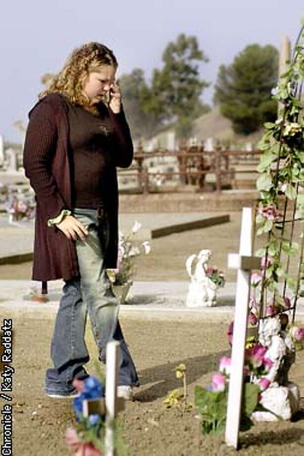 PHOTO BY KATY RADDATZ--THE CHRONICLE  Madi Eastman, age 12, is a cancer survivor. Madi has been visiting the grave of her friend Merisa Rojas, who died of cancer, for 4 years. Madi was determined that Merisa get a headstone, and through various efforts, the stone is being made. SHOWN: Madi visits the grave of Merisa. Photo: KATY RADDATZ