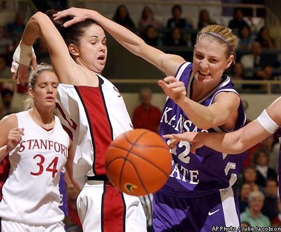 Kansas State's Brie Madden, right, and Stanford's Katie Denny, second from left, watch as the ball gets away during the first half of the Stanford Tournament championship game Saturday, Nov. 30, 2002, in Stanford, Calif. (AP Photo/Julie Jacobson) Photo: JULIE JACOBSON