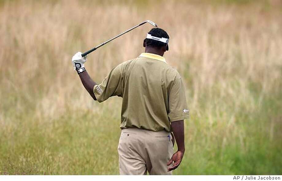 V.J. Singh walks through fescue at Shinnecock Hills Golf Club during a practice round at the U.S. Open Monday, June 14, 2004 in Southampton, N.Y. (AP Photo/ )