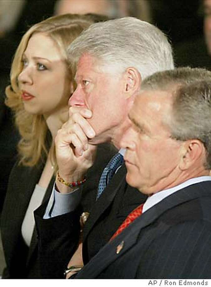 Former President Clinton, center, President Bush, right, and Chelsea Clinton, left, participate in a ceremony for the unveiling of the Clinton portraits, Monday, June 14, 2004, in the East Room of the White House. (AP Photo/Ron Edmonds) Photo: RON EDMONDS
