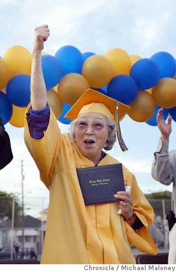 Holding her new diploma, Rayko Sekiguchi gives a thumbs up gesture to fellow graduating seniors and thanked them for their support.  Rayko Sekiguchi, 79, graduated from Emery High this evening, 62 years after she and her family were whisked off to an internment camp for Japanese Americans during World War II. She was an honorary graduate at the Emeryville school.  Photo by Michael Maloney / San Francisco Chronicle Photo: Michael Maloney