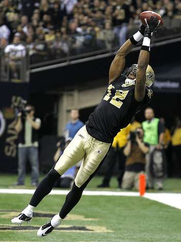 New Orleans Saints wide receiver Marques Colston (12) pulls in a touchdown pass during the first quarter of an NFL football game against the Carolina Panthers in New Orleans, Sunday, Jan. 1, 2012. The Saints set a franchise season scoring record on the play. (AP Photo/Bill Haber) Photo: Bill Haber, Associated Press