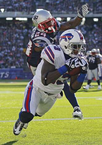 Buffalo Bills wide receiver Steve Johnson (13) hauls in a touchdown pass after beating New England Patriots defensive back Kyle Arrington (24) during the first quarter of an NFL football game in Foxborough, Mass., Sunday Jan. 1, 2012. (AP Photo/Elise Amendola) Photo: Elise Amendola, Associated Press