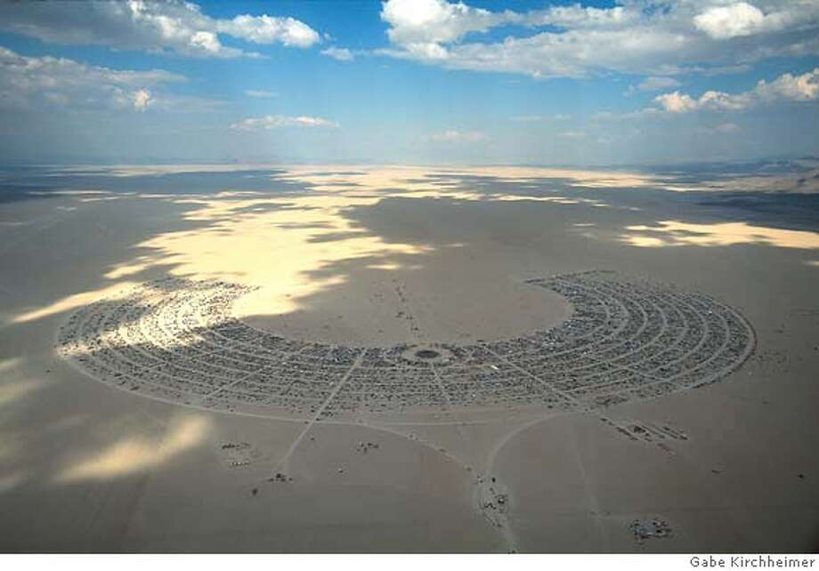 Burning Man 2000 Black Rock Desert, Nevada USA 30,000 people live in Black Rock City for one week only before it is disassembled and the playa is restored to its pristine state. Contents Copyright 2004. All rights reserved. These images may not be copied or reproduced by any means, except with the explicit permission of Gabe Kirchheimer. � 2003 Gabe Kirchheimer  720 Fort Washington Ave.  New York, NY 10040 USA  (212) 927-6384  gmoses@nyc.rr.com Photo: � 2004 Gabe Kirchheimer