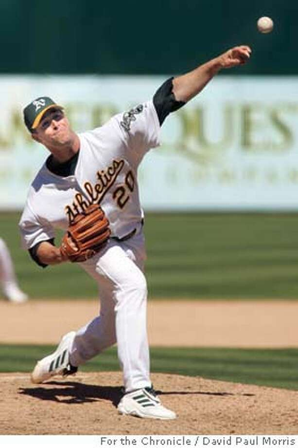 OAKLAND, CA - JUNE 13: Starting pitcher #20 Mark Maulder of the Oakland Athletics pitches during the game against the Pittsburgh Pirates on June 13, 2004. Maulder went on to become the winning pitcher after the A's beat the Pirates 13-3 Photograph by David Paul Morris/The Chronicle