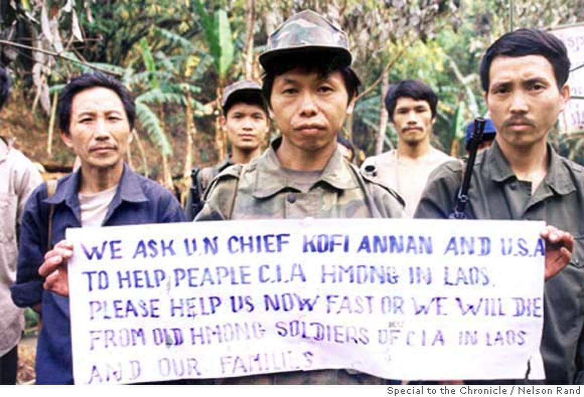 Former soldiers of a CIA-backed 'secret' army that fought communist forces in Laos during the Vietnam War hold up a sign pleading for US and UN help. The soldiers�never surrendered in 1975 and have been fighting a low-level insurgency for the past 29 years. They are currently surrounded by Laotian forces and are convinced that unless urgent action is taken to help them, they will all die. Picture taken�at the group's headquarters in Xaysomboune Special Zone, northern Laos, in April 2004. Special to the Chronicle / Nelson Rand PHOTO CREDIT: NELSON RAND/SPECIAL TO THE CHRONICLE ONE-TIME USE ONLY