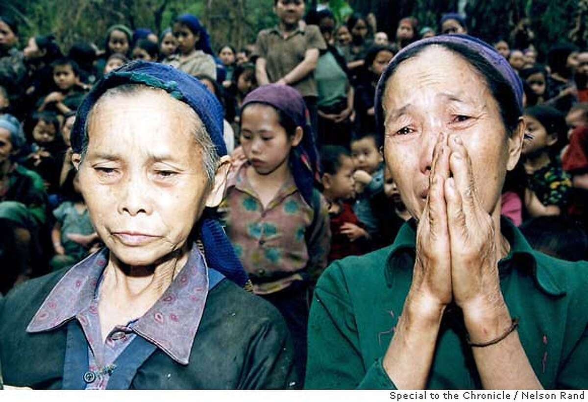 Hmong women plead for help in the Xaysomboune Special Zone, Northern Laos, April, 2004 PHOTO CREDIT: NELSON RAND/SPECIAL TO THE CHRONICLE ONE-TIME USE ONLY