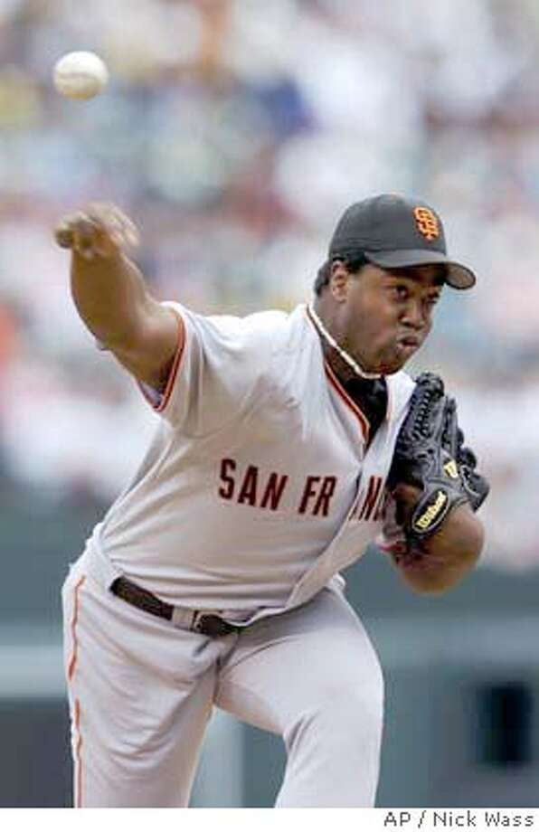 San Francisco Giants pitcher Jerome Williams delivers against the Baltimore Orioles Sunday, June 13, 2004, at Camden Yards in Baltimore.(AP Photo/Nick Wass) Photo: NICK WASS