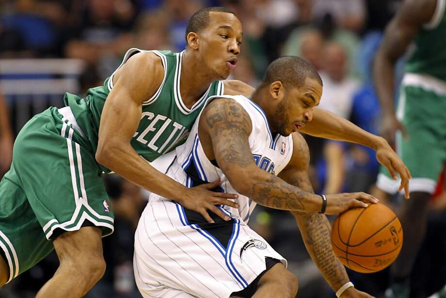 Orlando Magic's Jameer Nelson, right, drives past Boston Celtics' Avery Bradley during the first half of an NBA basketball game on Thursday, Jan. 26, 2012, in Orlando, Fla. (AP Photo/Mike Carlson) Photo: Mike Carlson, Associated Press