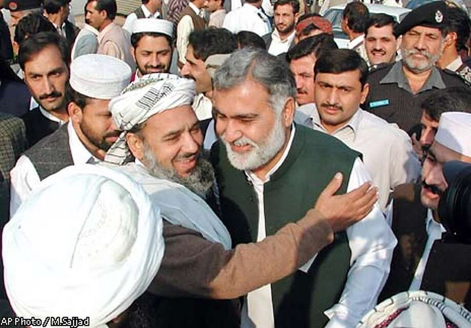 Akram Durrani, center in black vest, of the Mutahida Majlis-e-Amal, or United Action Forum religious coalition, is greeted by lawmakers after his victory as chief minister of the North West Frontier Province, a conservative region bordering Afghanistan, Friday, Nov 29, 2002 in Peshawar, Pakistan. (AP Photo/M.Sajjad) Photo: M.SAJJAD