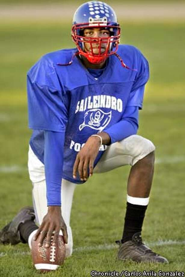 San Leandro High School quarterback Dennis Dixon during practice on Tuesday, November 24, 2002. The senior is poised to break every Hayward Area Athletic League record, and is ranked #6 in the country for high school quarterbacks. (BY CARLOS AVILA GONZALEZ/THE SAN FRANCISCO CHRONICLE) Photo: CARLOS AVILA GONZALEZ