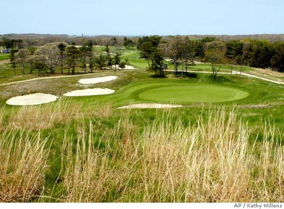** ADVANCE FOR WEEKEND EDITIONS JUN 12 - 13 ** High grasses surround the 14th hole at Shinnecock Hills Golf Club, the site of the 2004 United States Open Golf Championship Monday, May 10, 2004, in Southampton, N.Y. This spot is the highest point of the 6,996 yard historic course, considered the first top-notch golf course in the United States. (AP Photo/Kathy Willens) Photo: KATHY WILLENS