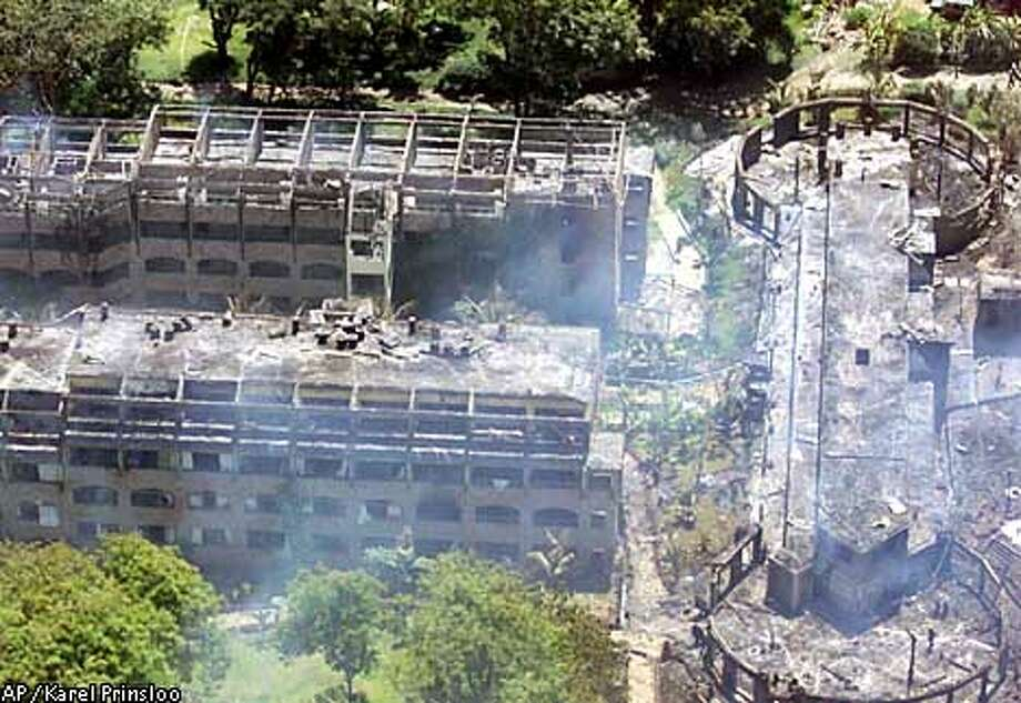 ** RECROPPED VERSION OF XKP101 **An aerial view of the Paradise Hotel in Kikambala, near Mombasa, Kenya Thursday Nov, 28 , 2002 after it was devastated in an explosion. In simultaneous attacks on Israeli tourists in Kenya, a car bomb exploded at the Israeli-owned hotel killing 11 people, and at least two missiles were fired at an Israeli airliner that had just departed the city of Mombasa for Tel Aviv. The hotel explosion killed six Kenyans, two Israelis and three people who were insidea vehicle thatcrashed through the Paradise Hotel's barrier and rammed into its reception area before exploding.(AP Photo/Karel Prinsloo) Photo: KAREL PRINSLOO