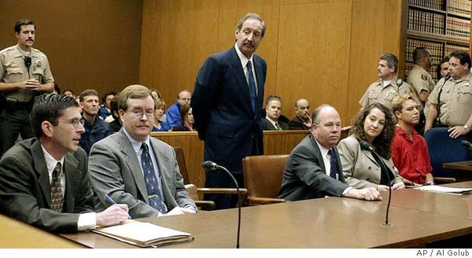 ** ADVANCE FOR USE MONDAY, MAY 31, 2004 - FILE ** Defense attorney Mark Geragos, standing center, listens as senior deputy district attorney Rick Distaso, left, speaks during a hearing for Scott Peterson, far right, in a Stanislaus County Superior courtroom May 2, 2003, in Modesto, Calif. Geragos, the mustachioed man in crisply pressed suits with a love for cigars and an easy swagger in his walk, is the man of the hour while Distaso is heading into the case of his career. Distaso is neatly groomed, nota hair out of place, a former Army attorney who attained the rank of captain. (AP Photo/Al Golub, Pool) Prosecutor Rick Distaso (left) and colleague David Harris (center) are pitted against defense attorney Mark Geragos (right). Prosecutor Rick Distaso (left) and colleague David Harris (center) are pitted against defense attorney Mark Geragos (right). Prosecutor Rick Distaso (left) and colleague David Harris (center) are pitted against defense attorney Mark Geragos (right). Prosecutor Rick Distaso (left) and colleague David Harris (center) are pitted against defense attorney Mark Geragos (right). Ran on: 06-13-2004  Mark Geragos (standing), defense attorney for Scott Peterson, listens as Deputy District Attorney Rick Distaso (left) speaks in a Stanislaus County courtroom. At center is Dave Harris, Distaso's colleague. Photo: AL GOLUB