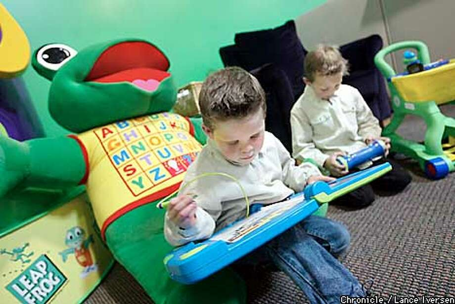 Frank kossak age 5 plays with a LeapPad (CQ )learning system while his brother Jack Kossak age 6 play with a Turbo Twist Brian Quest at Emeryville's Leap Frog headquarters.The boys are from Piedmont. By LANCE IVERSEN/SAN FRANCISCO CHRONICLE Photo: LANCE IVERSEN