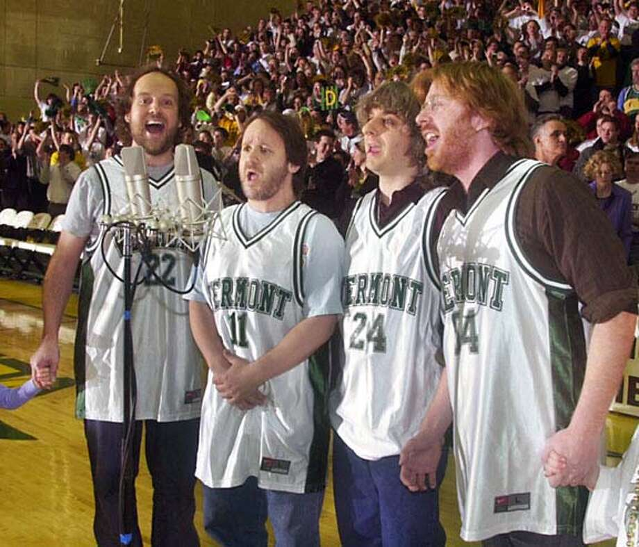 ** FILE ** Phish sings the national anthem before the start of the America East Men's Championship basketball game between the University of Maine and the University of Vermont in this March 13, 2004 file photo at the Patrick Gymnasium in Burlington Vt. From left are Paige McConnell; Jon Fishman; Mike Gordon; and Trey Anastasio. The enormously popular jam band that experimented with myriad musical genres and whose legions of dedicated fans made them a younger version of The Grateful Dead, announced Tuesday, May 25, 2004, that they are breaking up. They will still embark on a summer tour June 17 at Coney Island in New York. (AP Photo/The Burlington Free Press, Glenn Russell, File) Ran on: 06-13-2004  Photo caption Photo: GLENN RUSSELL