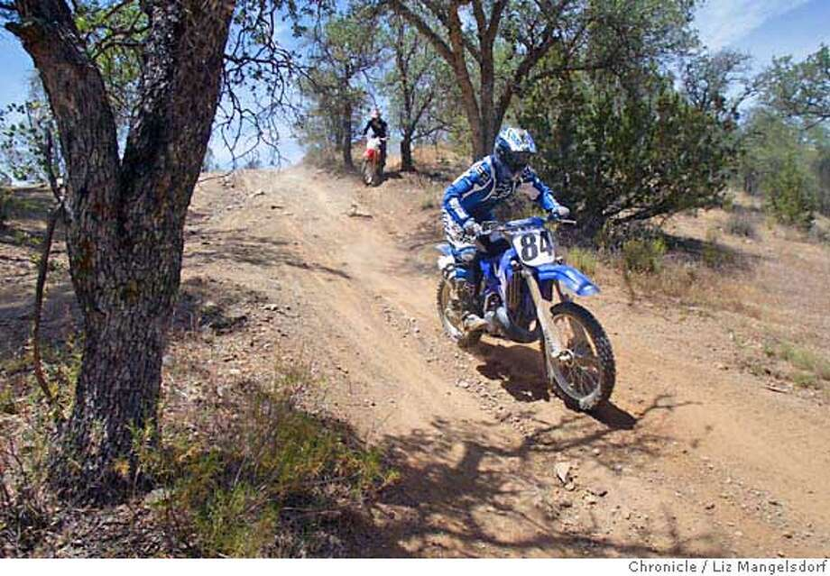 Event on 5/8/04 in Clear Creek Management Area.  Dave Wiseman, from Los Gatos, rides in the Clear Creek Management Area.  The 50,000 acre Clear Creek Management Area in San Benito County is considered by dirt bike riders to be one of the ten best places in the US to trail ride. But the area has lots of naturally occurring asbestos.  Liz Mangelsdorf / The Chronicle Photo: Liz Mangelsdorf