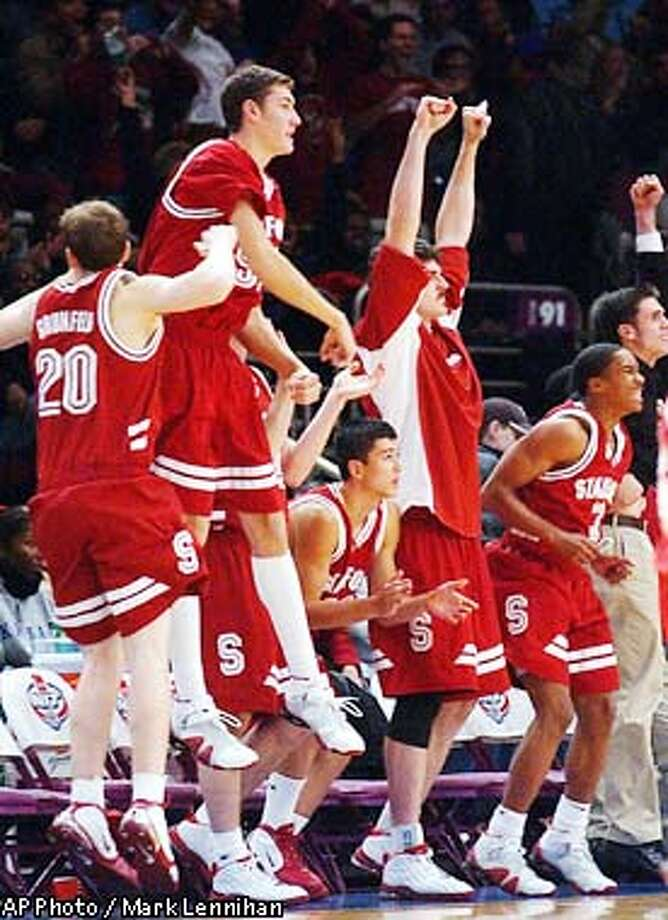 The Stanford bench reacts in the final minute of play as Stanford leads Florida in a semifinal of the Pre-Season NIT Wednesday, Nov. 27, 2002 in New York. Stanford held on to win 69-65. (AP Photo/Mark Lennihan) Photo: MARK LENNIHAN